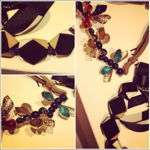 The dragonflies & the abstract cubic black ribbon necklaces.